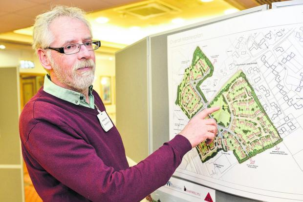 This Is Wiltshire: Graeme Towle, from TSH Architects  showing residents of South Marston the plans for redevelopment of Crown Timber and Thornhill Industrial Estates to provide 150 new homes