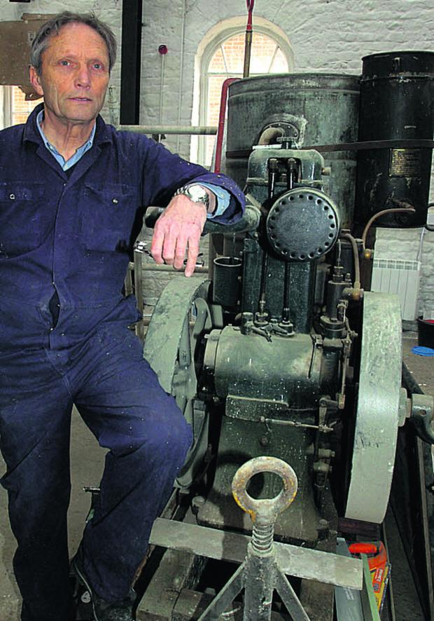 This Is Wiltshire: Paul Cowan with a 1920s Whatleys & Co water pump at Pewsey Heritage Centre