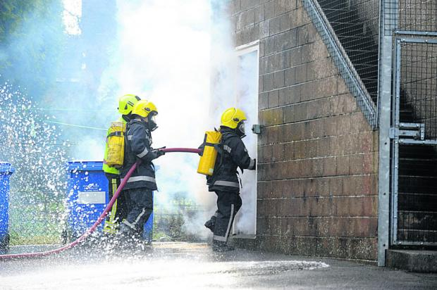 This Is Wiltshire: Young jobseekers get to grips with hoses to boost their self-confidence