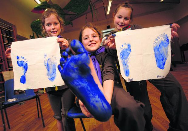 This Is Wiltshire: Emily, Isabelle and Isobel paint their feet to learn about pressure on hard and soft surfaces