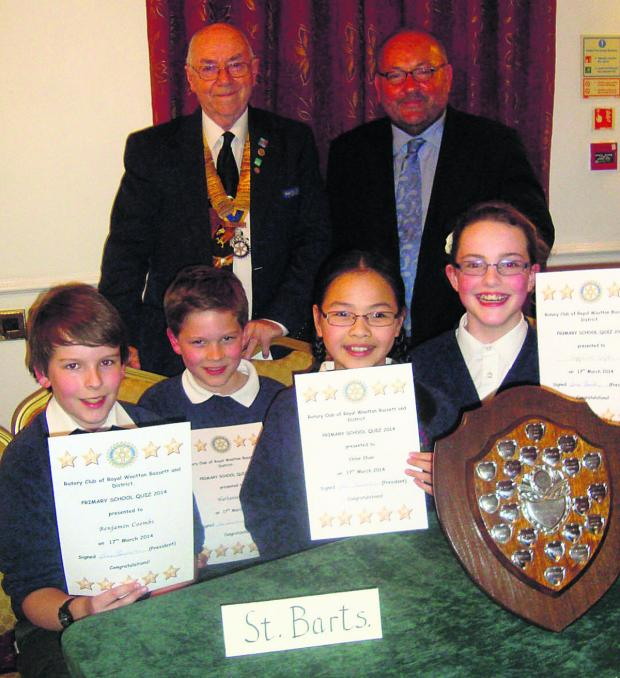 This Is Wiltshire: St Bartholomew's winning team, pictured with Rotary President Dave Fenwick and question master Mark Hazzard, are Benjamin Coombs, Nathaniel Ray, Chloe Chan and Sapphire Colpus