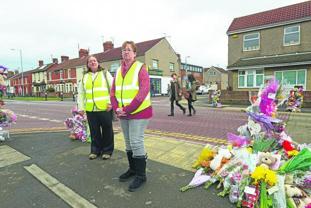 This Is Wiltshire: Sarah Evans, head of Moredon speedwatch, left,  with Thirza Noden at the site of the fatal accident