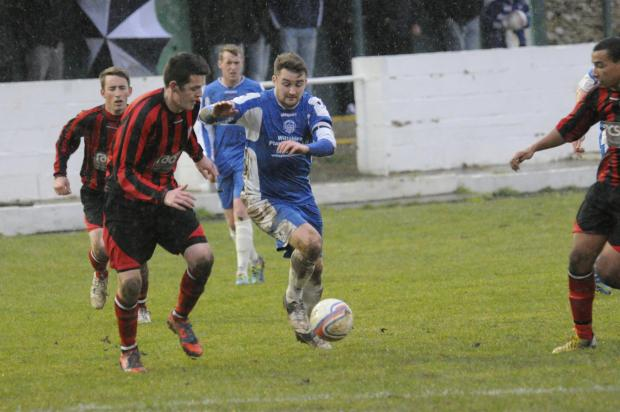 This Is Wiltshire: Jack Metcalf (left) got the only goal of the game as Warminster Town beat Chard Town 1-0 last night