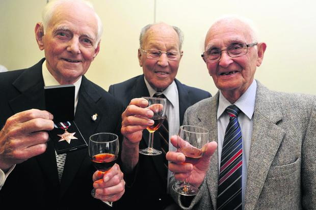 This Is Wiltshire: Gilbert Grace,of Trowbridge, left,  Denis Pickett of Holt and Joseph Grant of Trowbridge at the Arctic Convoy Star presentations last year