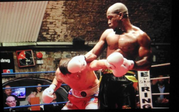 This Is Wiltshire: Swindon boxer Lawrence Bennett in action last night