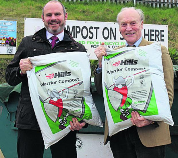 This Is Wiltshire: Mike Hill, chief executive of the Hills Group, and John Blake, secretary of CPRE Wiltshire, with some of the compost being offered to villages entering the Best Kept Village competition