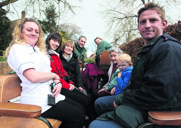 This Is Wiltshire: From left, carer Claire Hayden, Harriett Holloway, Patricia Holloway, Alan Hepper, Kathy Hepper, Joan Flint and Rory and Chris Jack take a ride on a horse-drawn carriage to mark Mrs Flint's 90th birthday