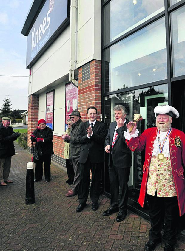 This Is Wiltshire: Town crier Trevor Heeks opens the new HJ Knee store