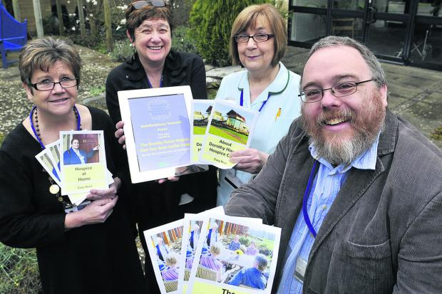 This Is Wiltshire: Matt Carter, right, the ,designer of the easy-read information leaflet with Helen Scammell, left, director of people and development, Gill Cannon , director of communications and Chris Johnson, an in-patient nursing auxillary