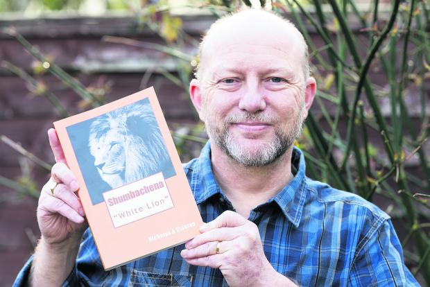 This Is Wiltshire: Nicholas Stanton with his book Shumbachena White Lion, which is about poaching in Zimbabwe