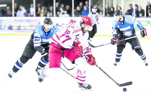This Is Wiltshire: Swindon Wildcats in action. Their fans need help covering the cost of transport to Coventry tomorrow