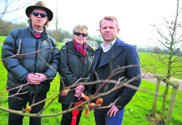 This Is Wiltshire: Pipers Area Residents' Association is looking to protect Croft sports field as green space. Left to right are David Bent, Bea Menier and Colin Doubleday
