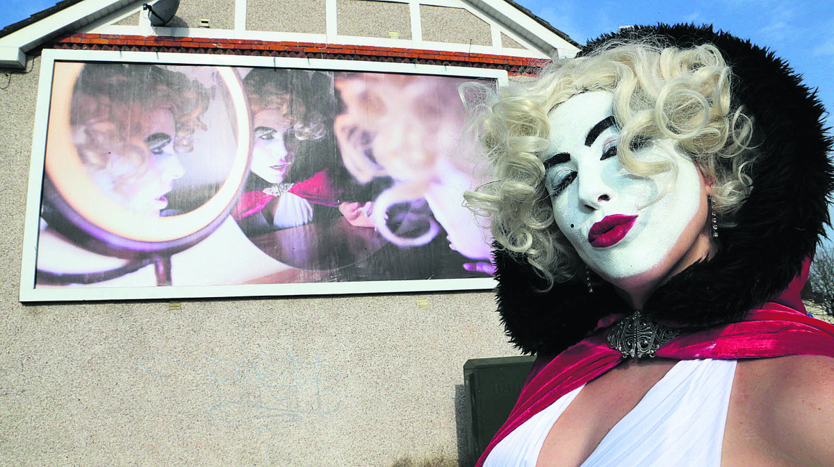 Artist Katie Brightside with her piece of art which was exhibited on a billboard on the Magic Roundabout at the weekend. Picture: STUART HARRISON