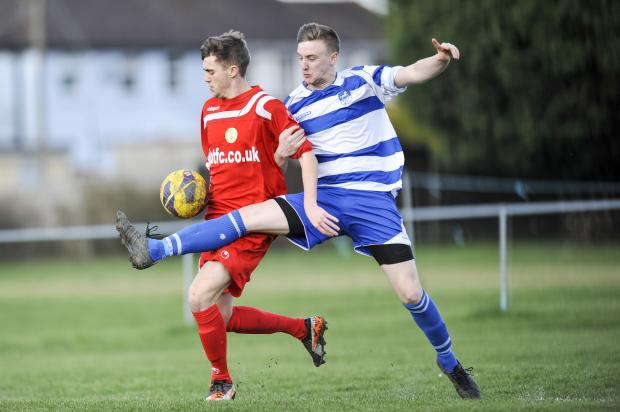 This Is Wiltshire: Action from the weekend clash between Wroughton and Wootton Bassett Town Dev