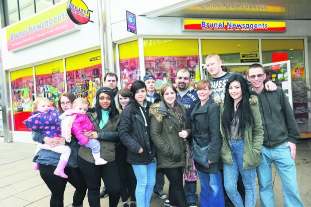 This Is Wiltshire: Brunel Newsagents has donated cash to a memorial for Ashley McKinnon, inset. Pictured Sober Dogan, centre, of Brunel Newsagents with friends of Ashley