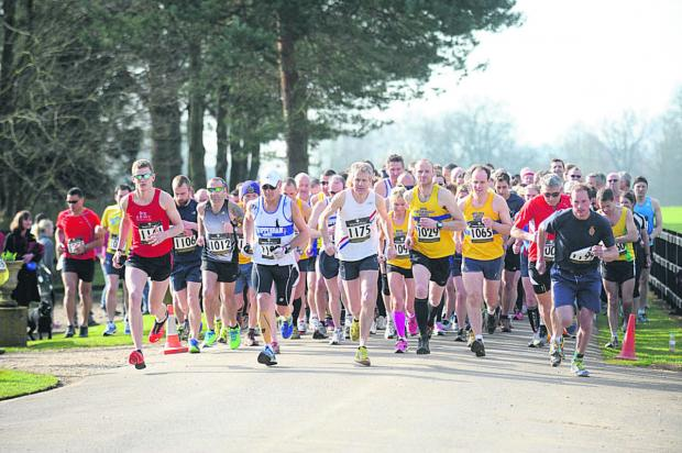 This Is Wiltshire: Runners head off at the start of the 10k run