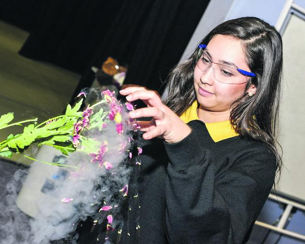 This Is Wiltshire: Maria Schoeps, from Isambard School, witnesses the effect of liquid nitrogen on a flower