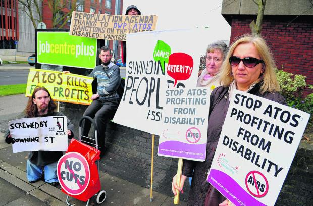 This Is Wiltshire: Demonstrators at the Jobcentre urge the government not to agree any more contracts with Atos