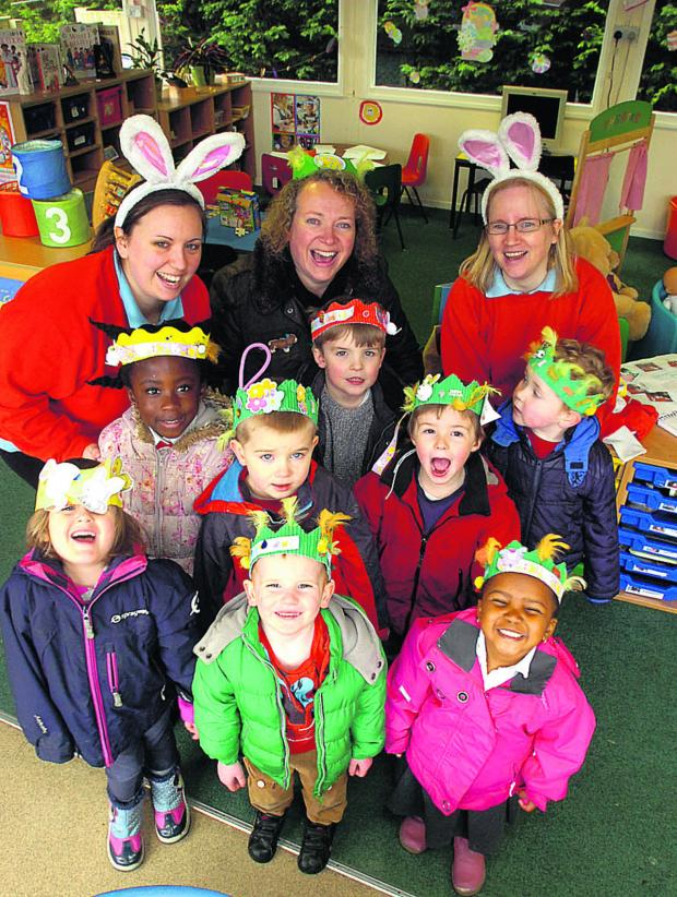 This Is Wiltshire: Pupils at Sunny Days Pre-school in Lyneham made Easter  bonnets. Pictured are Sam Taylor, Jean Rimmer and Martine Campbell with children and their bonnets