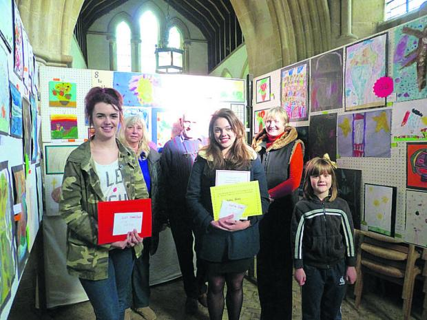 This Is Wiltshire: Prize winners Lily Shergold, Katie Sims and Emily Rees with judges Flora Rudd, Jeff Meddings and Val Craig