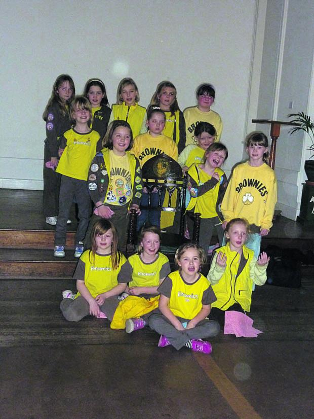 This Is Wiltshire: 1st Westbury Brownies with the mayor's chair at the Laverton, gleaming after they gave it a good polish