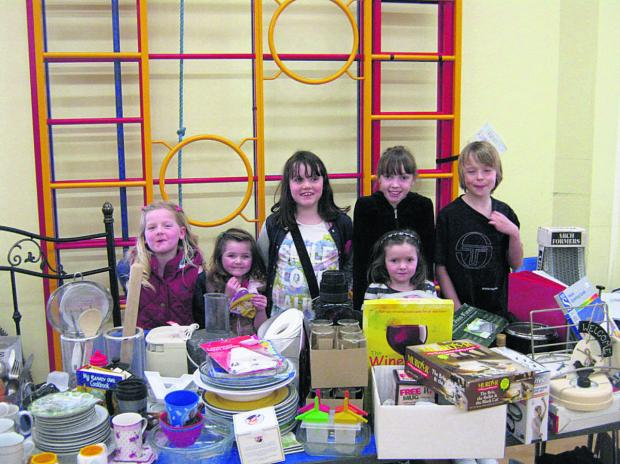This Is Wiltshire: Pupils came along to help with the jumble sale