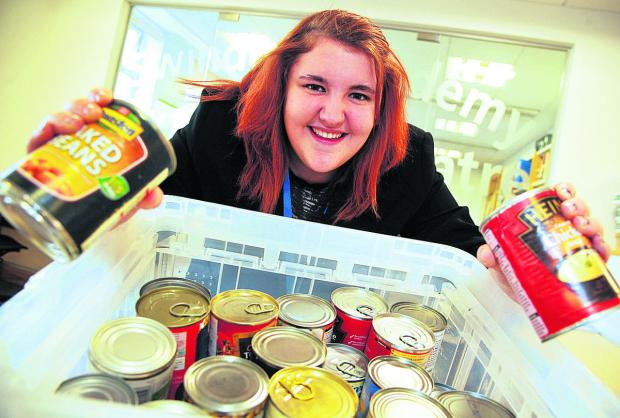 This Is Wiltshire: Kayleigh Shelton, from Swindon Academy, has collected boxes of food for Swindon Foodbank