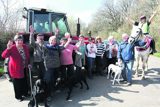 This Is Wiltshire: Residents, including John Davenport, second from right, are pleased about the closure