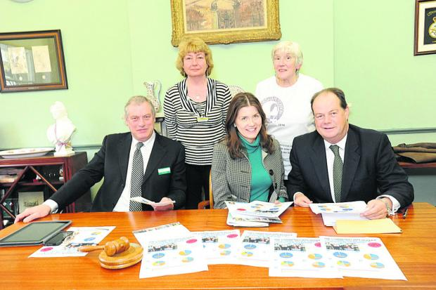 This Is Wiltshire: John Thompson of Wiltshire Council, PMP Michelle Donelan who compiled the survey, Railway Minister Stephen Hammond with, standing,  council chair Ruth Hopkinson and long-time campaigner Anne Lock