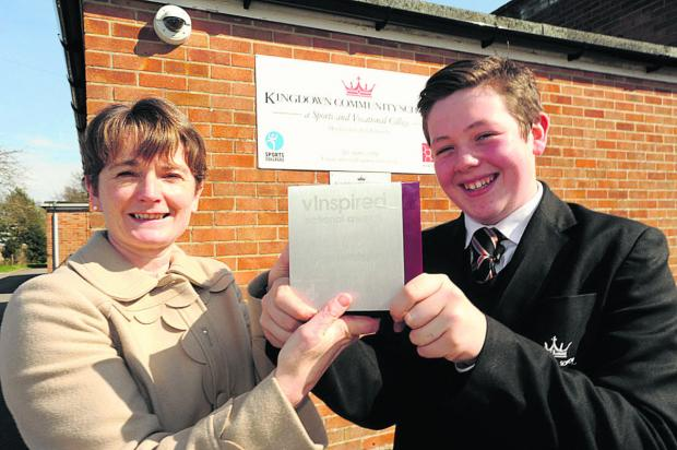 This Is Wiltshire: Kingdown headteacher Sara Edwards congratulates award-winning Kieran Strong