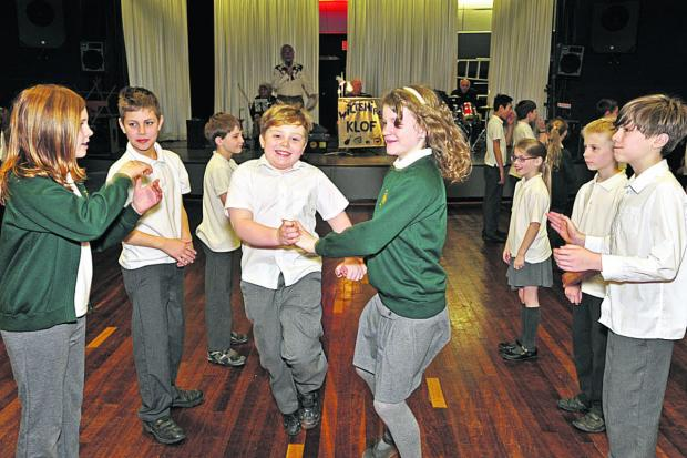 This Is Wiltshire: West Ashton Primary School pupils perform Bridge of Athlone during the annual schools' day of country dancing