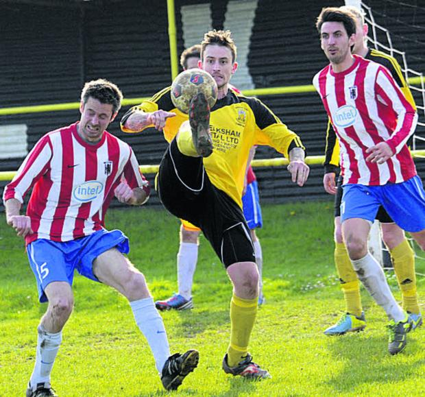 This Is Wiltshire: Melksham's Gary Perrott gets his toe to the ball in the Intel penalty area last weekend