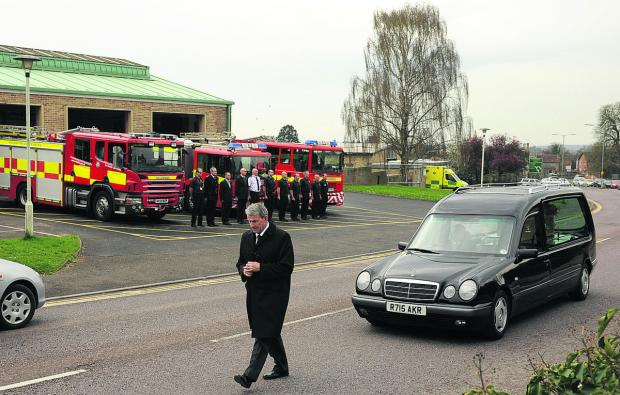 This Is Wiltshire: Firefighters stand in solemn tribute to Hugh Cook, inset, as his hearse passes the fire station on Wednesday en route to the crematorium.                     Photo: Trevor Porter