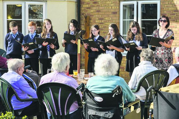 This Is Wiltshire: Year 9 Commonweal students singing to residents of Princess Lodge Care Home. Pictured, left to right, are Eddie Corner, Tom Fi