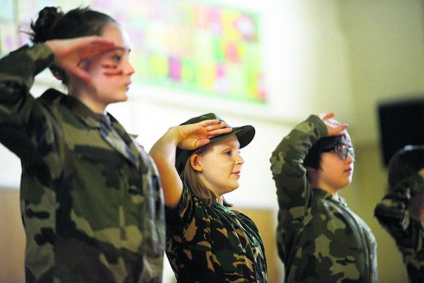 This Is Wiltshire: Red Oaks School pupils came to attention as they took on various roles to help  understand the history of the First World War