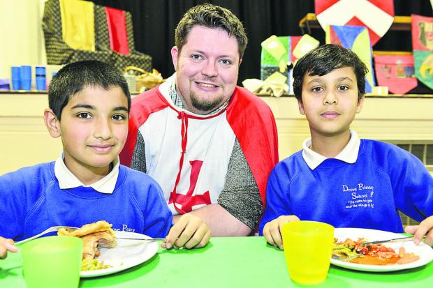 This Is Wiltshire: Yasin, teacher Chris Fox and  Rishabh at Drove Primary School's medieval banquet to end their knights and castles topic