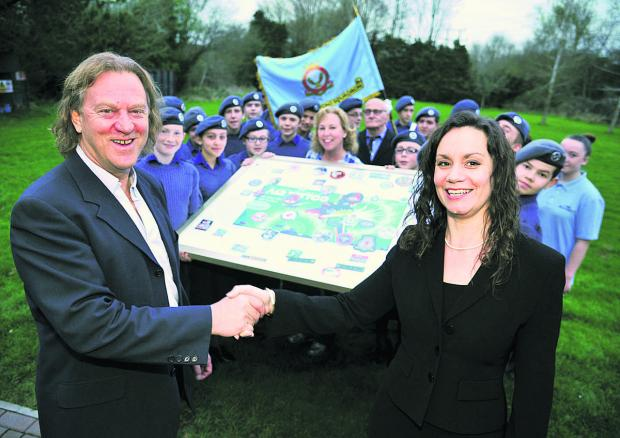 This Is Wiltshire: The Royal International Air Tattoo presents 2003 Stratton Squadron with art work after it won a national competiton.  From left, David Bent and  Helen Webb