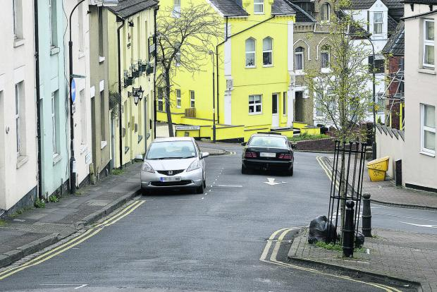This Is Wiltshire: A car going the wrong way down Prospect Hill as a result of the closure of Crombey Steet