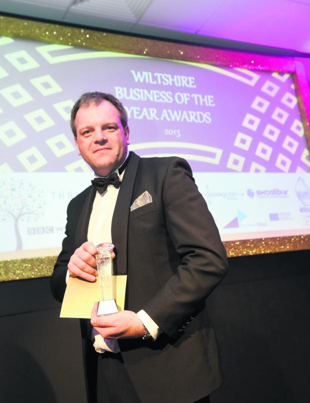 This Is Wiltshire: Pebley Beach MD Dominic Threlfall with the award for excellence