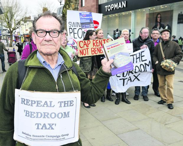 This Is Wiltshire: The People's Assembly protesting in Swindon town centre against the Bedroom Tax. Pictured front is Brian Shakespeare