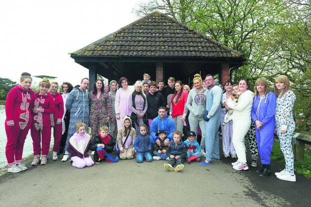 This Is Wiltshire: Family and friends of Charley Drewett Scanlon kitted out in their onesies