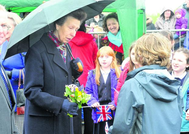 This Is Wiltshire: Princess Anne receives flowers from children during her visit to Devizes this morning