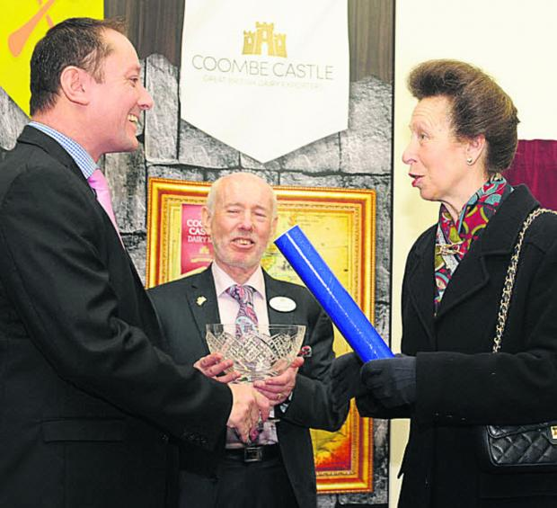 This Is Wiltshire: The Princess Royal presents the third Queen's Award for International Trade to Coombe Castle managing director Darren Larvin, left, and chairman Glyn Woolley