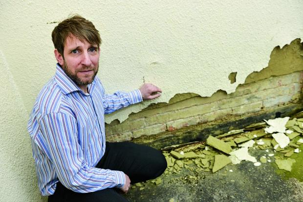 This Is Wiltshire: Andy Cuss, director of Artdeans, is one of a group of business owners who have found damage to their buildings due to vibrations caused by the drilling works around the Outlet Centre