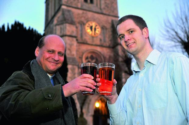 This Is Wiltshire: The Rev Simon Stevenette and church warden Gareth Hutchinson raise a glass at Christ Church