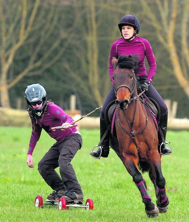 This Is Wiltshire: Anita Walker rides on as her horse pulls Jon Strike on his board