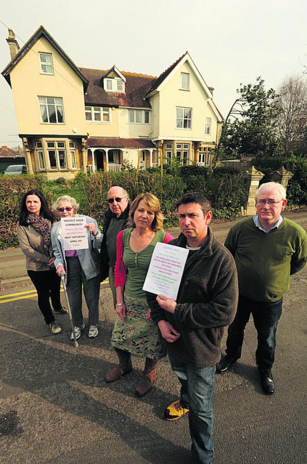 This Is Wiltshire: Richard Hall, partner Kate Drew and other residents unhappy about development plans for Greenwood House