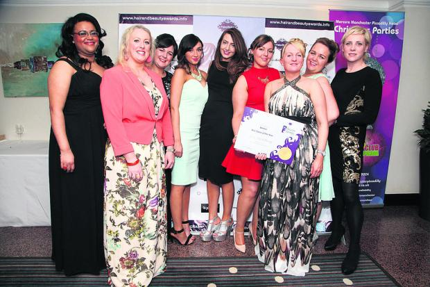 This Is Wiltshire: From left: Natasha Clarke, Vanda Tanner, Rachael Pearce, Amy Stepp, Penny Rogers, Jodie Silvester, Becky Tanner, Victoria Hearn and Rachael Jelley of OMG hair salon