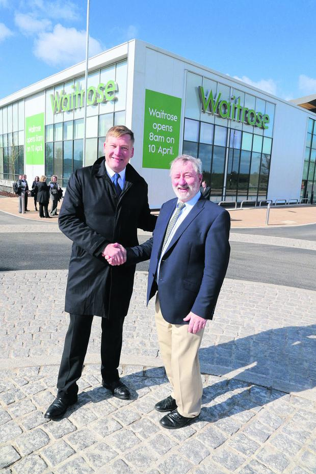 This Is Wiltshire: Housing Minister Kris Hopkins with Coun Wayne Crabbe during his visit to Swindon where he visited the soon to open Waitrose store at Wichelstowe