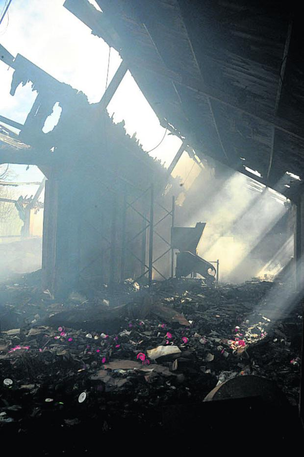 This Is Wiltshire: The scene today after the fire at a former Neston factory